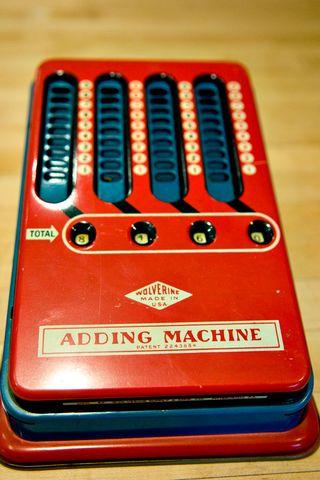 Finds-toy-adding-machine